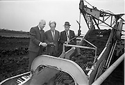 23/09/1963<br /> 09/23/1963<br /> 23 September 1963<br /> Minister sees advances in peat productivity by Bord na Mona at Timahoe, Co. Kildare. Picture shows Mr Dermot C. Lawlor, (left) Managing Director, Bord na Mona showing the Minister for Transport and Power, Mr Erskine Childers an automatic sod collector at Timahoe turf works, during the minister's end of season visit to Bord na Mona installations. On right is Mr Eugene Redehan, Chief Civil Engineer, Bord na Mona.