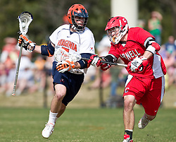 Virginia Cavaliers M/A Steve Giannone (5) is defended by Cornell Big Red M Peter Grom (9).  The #1 ranked Virginia Cavaliers defeated the #4 ranked Cornell Big Red 14-10 at Klockner Stadium on the Grounds of the University of Virginia in Charlottesville, VA on March 8, 2009.