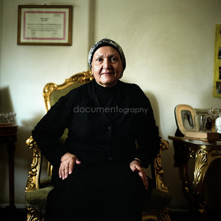 Inas Sadek, 67, widowed, at home in Cairo, Egypt.