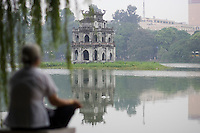Early morning at Hoa Kiem Lake at the Tortoise Pagoda. Hanoi, estimated population 3,058,000(2004), is the capital of Vietnam. From 1010 until 1802, it was the political center of an independent Vietnam with a few brief interruptions. It was eclipsed by Hu during the Nguyen Dynasty as the capital of Vietnam, but served as the capital of French Indochina from 1887 to 1945. From 1945 to 1976, it was the capital of North Vietnam..The city is located on the right bank of the Red River. Hanoi is located 1760 km (1094 mi) north of Ho Chi Minh City (formerly Saigon). .