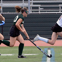 Radnor's Katie Quinn (13) runs with the ball as Ridley's Erin O'Kane (40) and Kellie McDermott (28) try to catch her during the Radnor at Ridley field hockey game, Thursday afternoon September 11, 2014. (Times staff / TOM KELLY IV)