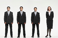 Businesspeople standing side by side arms by side behind back