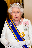 Queen Elizabeth II during State Banquet at Buckingham Palace, on the first of the 2 day state visit by the Dutch Royal Pair to the UK. Queen Maxima is wearing a rare crown, with a Stuart diamond, the Dutch Royal family inherited from King William and Queen Mary in 1702, when King William died. copyright robin utrecht