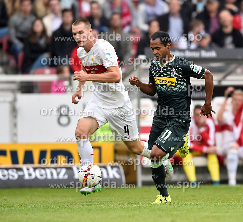 26.09.2015, Mercedes Benz Arena, Stuttgart, GER, 1. FBL, VfB Stuttgart vs Borussia Moenchengladbach, 7. Runde, im Bild Raffael Borussia Moenchengladbach auf dem Weg zum TOR zum 1:3 gegen Toni Sunjic VfB Stuttgart // during the German Bundesliga 7th round match between VfB Stuttgart and Borussia Moenchengladbach at the Mercedes Benz Arena in Stuttgart, Germany on 2015/09/26. EXPA Pictures &copy; 2015, PhotoCredit: EXPA/ Eibner-Pressefoto/ Weber<br /> <br /> *****ATTENTION - OUT of GER*****