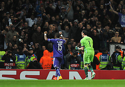 Anderlecht's Silvio Proto and Anderlecht's Gohi Bi Cyriac celebrate in front of their fans as they clinch a draw late on in the game - Photo mandatory by-line: Dougie Allward/JMP - Mobile: 07966 386802 - 04/11/2014 - SPORT - Football - London - Emirates Stadium - Arsenal v RSC Anderlecht - Champions League - Group D