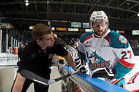 KELOWNA, CANADA - MAY 13: Brendan Hait, equipment manager speaks to Josh Morrissey #27 of Kelowna Rockets during warm up against the Brandon Wheat Kings on May 13, 2015 during game 4 of the WHL final series at Prospera Place in Kelowna, British Columbia, Canada.  (Photo by Marissa Baecker/Shoot the Breeze)  *** Local Caption *** Brendan Hait; Josh Morrissey;