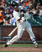 San Francisco Giants first baseman Buster Posey (28) swings at a Colorado Rockies pitch at AT&T Park in San Francisco, California, on September 20, 2017. (Stan Olszewski/Special to S.F. Examiner)
