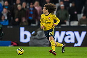 Matteo Guendouzi (Arsenal) in action having come onto the pitch as a substitute in the 2nd half during the Premier League match between West Ham United and Arsenal at the London Stadium, London, England on 9 December 2019.