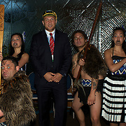Georgian player Levan Datunashvili poses with Maori performers during the Georgia Rugby Teams official Civic welcome and cap presentation at Skyline.  Queenstown, New Zealand, 6th September 2011. Photo Tim Clayton..