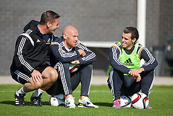 NEWPORT, WALES - Tuesday, October 7, 2014: Wales' masseur David Rowe, James Collins and Gareth Bale during training at Dragon Park National Football Development Centre ahead of the UEFA Euro 2016 qualifying match against Bosnia and Herzegovina. (Pic by David Rawcliffe/Propaganda)