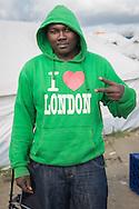 Calais, Pas-de-Calais, France - 17.10.2016    <br />  <br /> A sudanese refugee with a &quot;I love London&quot;-shirt. The man lives since 4 month in the &rdquo;Jungle&quot; refugee camp on the outskirts of the French city of Calais. Many thousands of migrants and refugees are waiting in some cases for years in the port city in the hope of being able to cross the English Channel to Britain. French authorities announced that they will shortly evict the camp where currently up to up to 10,000 people live.<br /> <br /> Ein sudanesischer Fluechtling mit einem &quot;I Love London&quot;-Pullover. Der Mann lebt seit 4 Monaten im &rdquo;Jungle&rdquo; Fluechtlingscamp am Rande der franzoesischen Stadt Calais. Viele tausend Migranten und Fluechtlinge harren teilweise seit Jahren in der Hafenstadt aus in der Hoffnung den Aermelkanal nach Gro&szlig;britannien ueberqueren zu koennen. Die franzoesischen Behoerden kuendigten an, dass sie das Camp, indem derzeit bis zu bis zu 10.000 Menschen leben K&uuml;rze raeumen werden. <br /> <br /> Photo: Bjoern Kietzmann