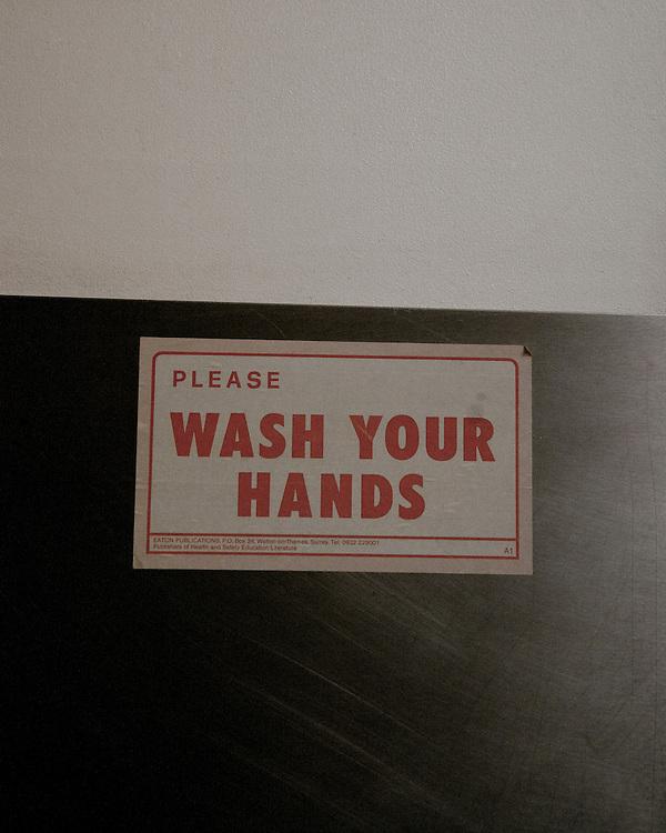 Wash your hands notice in a kitchen in an Indian Restaurent