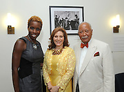 Hunter College President Jennifer J. Raab, center, with former New York City Mayor David Dinkins and Shola Olatoye, head of the New York City Housing Authority, at the Hunter College Summer Garden Party, Tuesday, July, 8, 2014, at Roosevelt House in New York.  (Photo by Diane Bondareff/Invision for Hunter College)