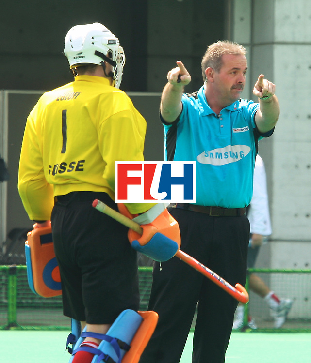 Kakamigahara (Japan):  Umpire Grime Murray awarding a penalty corner to Germans in the match against Switzerland at the Olympic Hockey Qualifierat Gifu Perfectural Green Stadium at Kakamigahara on 06 April 2008. Germany beat Switzerland 10-0. Photo: GNN/ Vino John