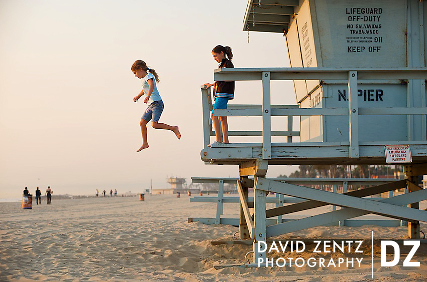 A girl appears weightless while jumping from a lifeguard tower at Venice Beach in Venice, Los Angeles, Calif., on Nov. 16, 2008.