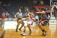 "Ole Miss' Valencia McFarland (3) drives against Arizona's Candice Warthen (24) at the C.M. ""Tad"" Smith Coliseum in Oxford, Miss. on Thursday, November 18, 2010. Arizona won 72-70."