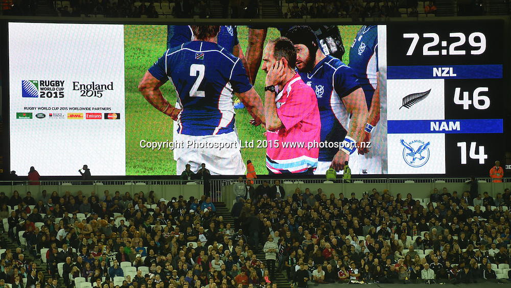 Referee Romain Poite waits for a TMO decision during the New Zealand All Blacks v Namibia Rugby World Cup 2015 match. The Stadium, Queen Elizabeth Olympic Park, London, UK. Thursday 24 Septebmer 2015. Copyright Photo: Andrew Cornaga / www.Photosport.nz