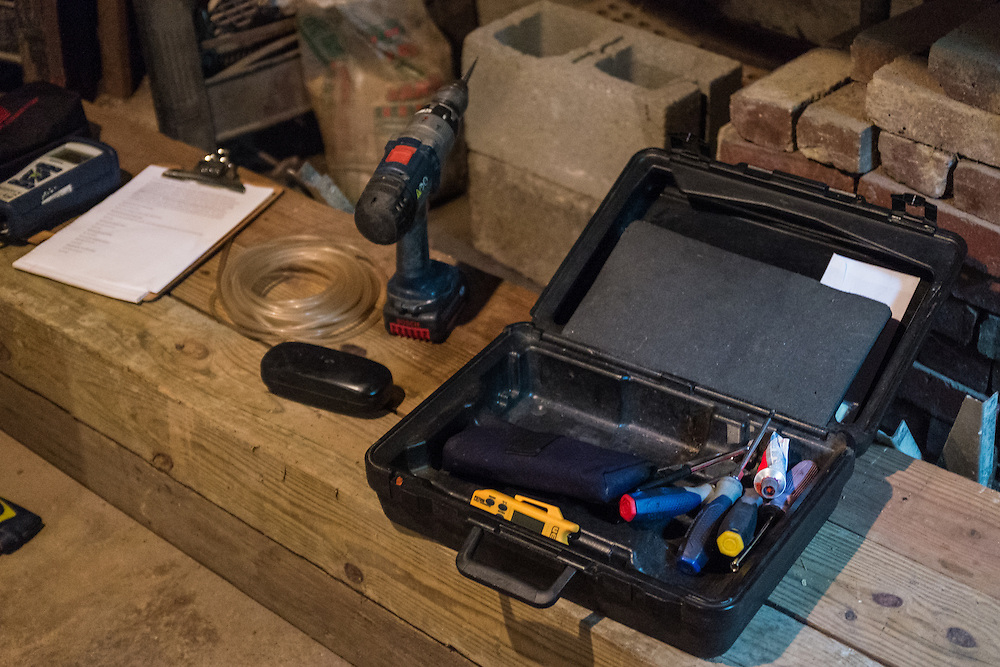 Some of Mike Lehman's tools await the start of a hot water tank inspection during an energy audit Tuesday, June 23, 2015.  Photo by Ohio University  /  Rob Hardin
