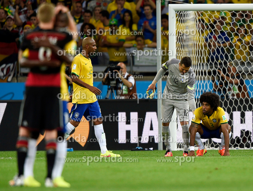 08.07.2014, Mineirao, Belo Horizonte, BRA, FIFA WM, Brasilien vs Deutschland, Halbfinale, im Bild Brazil's Dante (1st R) and goalkeeper Julio Cesar (2nd R) react // during Semi Final match between Brasil and Germany of the FIFA Worldcup Brazil 2014 at the Mineirao in Belo Horizonte, Brazil on 2014/07/08. EXPA Pictures &copy; 2014, PhotoCredit: EXPA/ Photoshot/ Qi Heng<br /> <br /> *****ATTENTION - for AUT, SLO, CRO, SRB, BIH, MAZ only*****