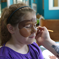 Natalie Lecure, 8, gets her face painted like a puppy Saturday at Tupelo Small Animal Hospital's open house