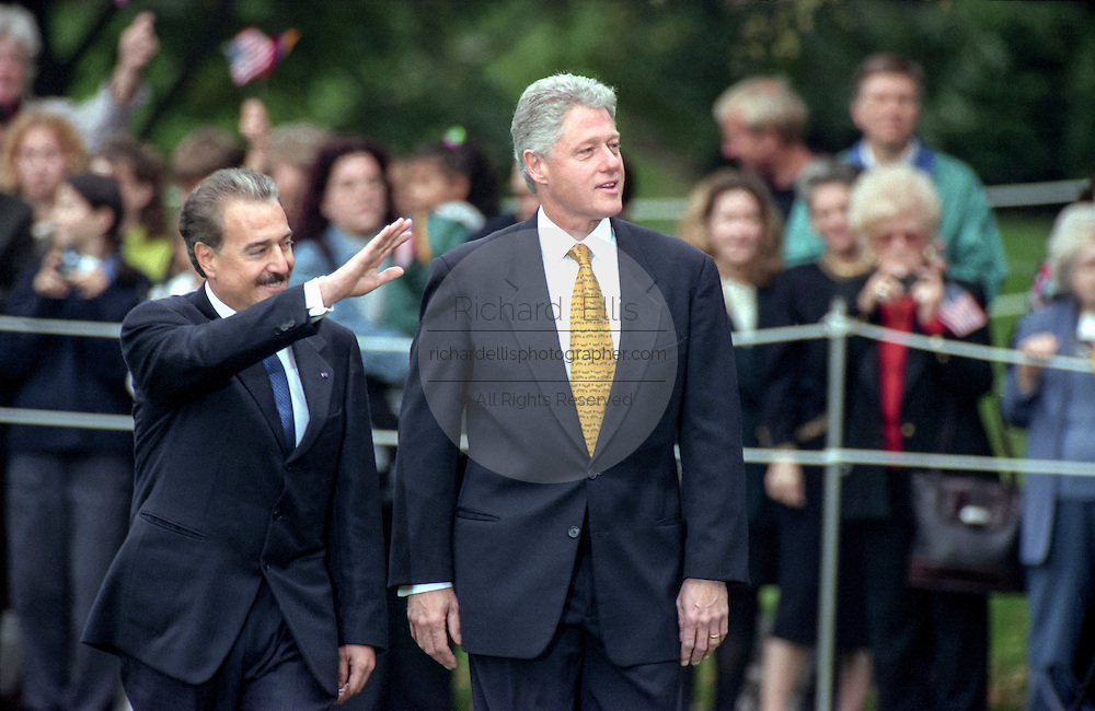 US President Bill Clinton escorts Colombian President Andres Pastrana during an arrival ceremony on the South Lawn of the White House October 28, 1998 in Washington DC.