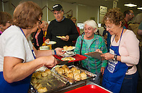 Sue Appleton and Sharon Fleischman help Marilyn Bolduc with her order including a pastrami sandwich, cheese blintzes and knishes during the 19th annual Jewish Food Festival at the Temple B'nai Isreal on Court Street Sunday morning.  (Karen Bobotas/for the Laconia Daily Sun)