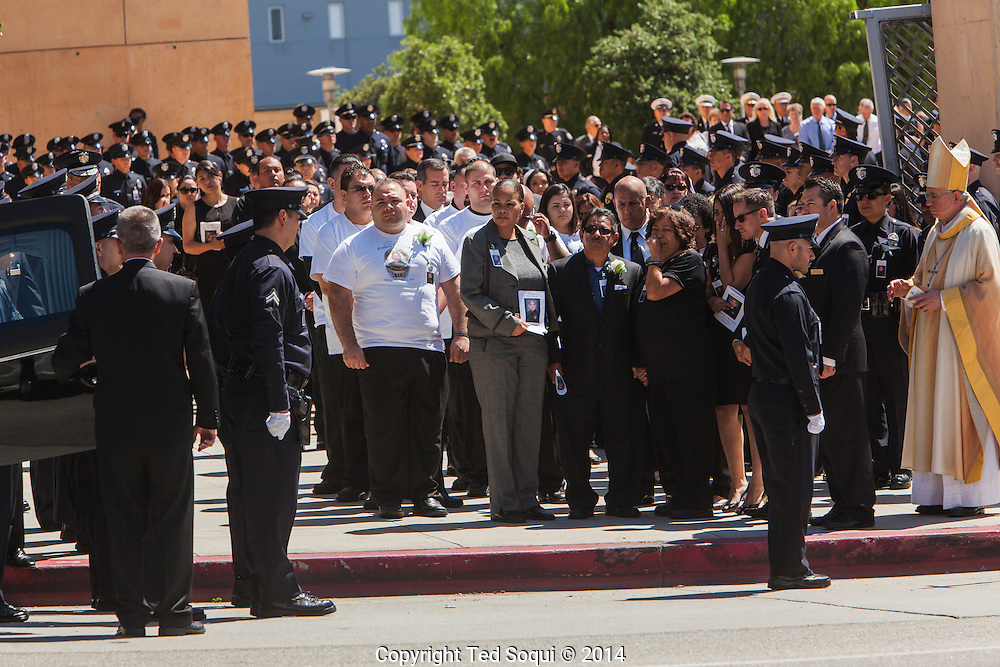 Friends and family of LAPD Officer Sanchez.<br /> Funeral Mass for LAPD Officer Roberto Sanchez held at the Cathedral of Our Lady of the Angels in Los Angeles. Officer Sanchez was killed while on duty during a police pursuit, when a suspects vehicle intentionally rammed Sanchez's LAPD cruiser.