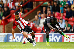 Nico Yennaris of Brentford intercepts the ball from Mame Biram Diouf of Stoke City - Mandatory by-line: Jason Brown/JMP - Mobile 07966 386802 25/07/2015 - SPORT - FOOTBALL - Brentford, Griffin Park - Brentford v Stoke City - Pre-Season Friendly