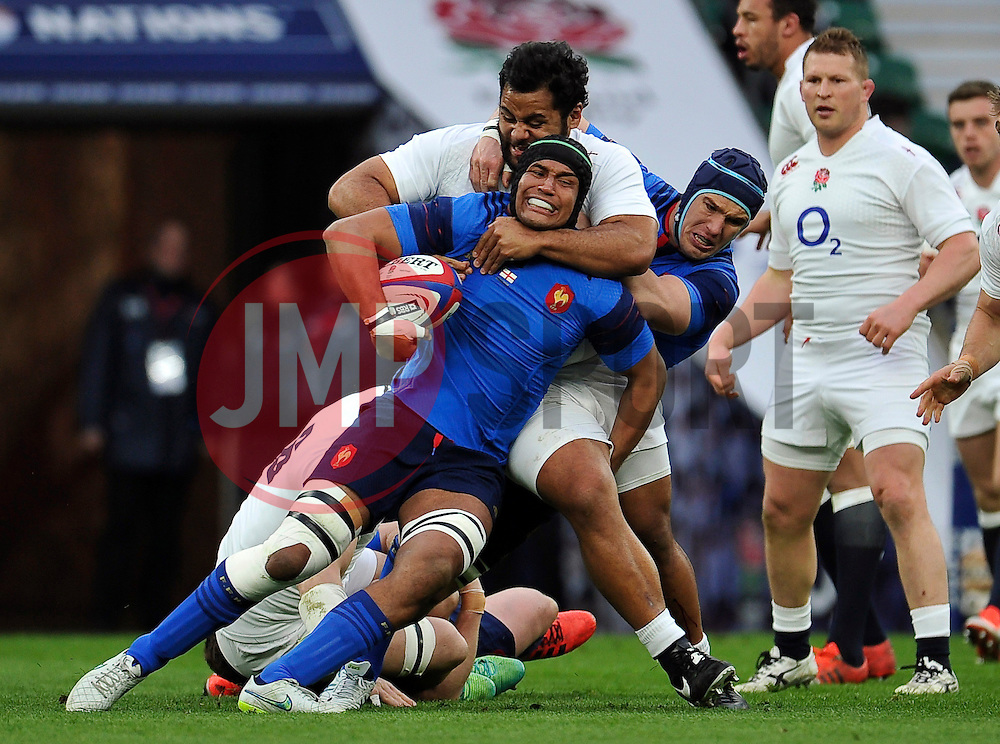Thierry Dusautoir of France is tackled by Billy Vunipola of England - Photo mandatory by-line: Patrick Khachfe/JMP - Mobile: 07966 386802 21/03/2015 - SPORT - RUGBY UNION - London - Twickenham Stadium - England v France - Six Nations Championship