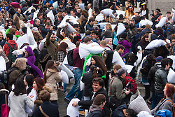 London, April 4th 2015. Hundreds of people take [part in a giant pillowfight in Trafalgar Square as the annual world pillowfight day gets underway.