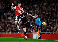 20111227: LONDON, UK - Barclays Premier League 2011/2012: Arsenal vS Wolverhampton Wanderers.<br /> In photo: Steven Fletcher of Wolverhampton Wanderers and Thomas Vermaelen of Arsenal leap for the ball.<br /> PHOTO: CITYFILES