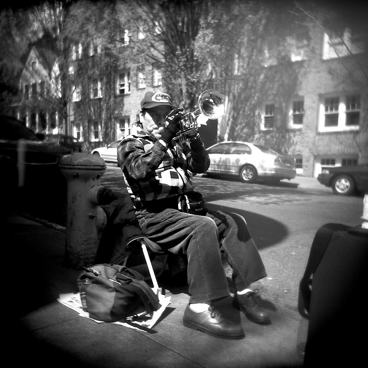 trumpet player, busker, busking