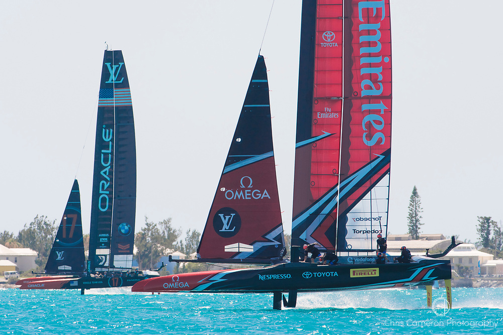 The Great Sound, Bermuda, 18th June. Emirates Team New Zealand leads against Oracle Team USA in race four on day two of the America's Cup.