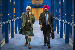 October 3, 2018 - Birmingham, West Midlands, UK - Two conservative delegates make their way to the main hall for the Prime Minister Theresa May's speech on the final day of the Conservative Party Conference being held at the International Convention Centre in Birmingham. (Credit Image: © Andrew Mccaren/London News Pictures via ZUMA Wire)