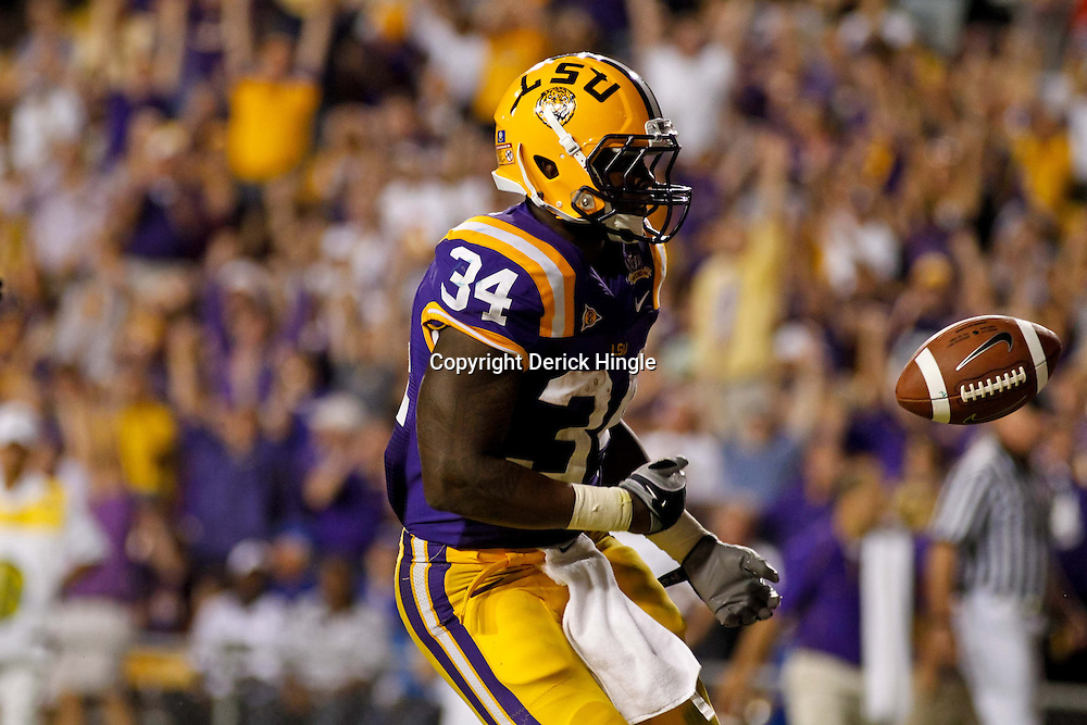 October 16, 2010; Baton Rouge, LA, USA; LSU Tigers running back Stevan Ridley (34) tosses the football to the referee after scoring a touchdown against the McNeese State Cowboys during a game at Tiger Stadium. LSU defeated McNeese State 32-10. Mandatory Credit: Derick E. Hingle