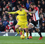 Nottingham Forest striker Nelson Oliveira challanging for the ball with Brentford defender Harlee Dean during the Sky Bet Championship match between Brentford and Nottingham Forest at Griffin Park, London, England on 21 November 2015. Photo by Matthew Redman.