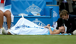 Switzerland's Martina Hingis receives treatment during the Women's Doubles Final during day nine of the AEGON International at Devonshire Park, Eastbourne.