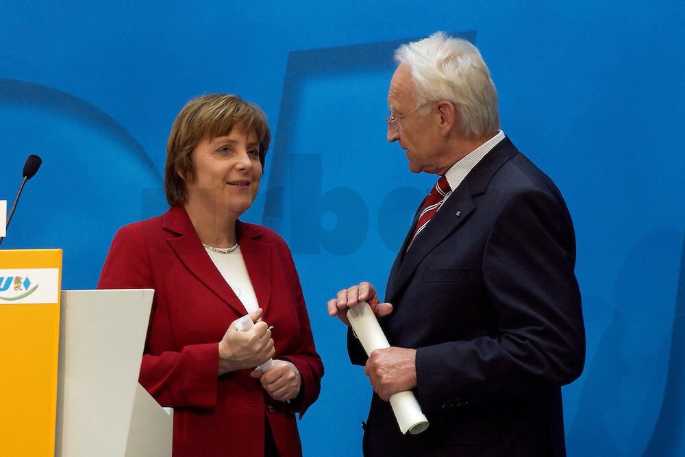 02 APR 2004, BERLIN/GERMANY:<br /> Angela Merkel (L), CDU Bundesvorsitzende, und Edmund Stoiber (R), CSU, Ministerpraesident Bayern, im Gespraech, nach einem Pressestatement zu dem vorangegangenem europapolitischen Spitzengespraech von CDU und CSU, Konrad-Adenauer-Haus<br /> IMAGE: 20040402-02-018<br /> KEYWORDS: Ministerpr&auml;sident, CDU Bundesgeschaeftsstelle, Gespr&auml;ch
