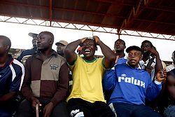 Spectators of football at Coup de Cameroon quarter final between Union Sportif de Douala and Canon de Yaounde at the military stadium in central Yaounde. Yaounde, Cameroon.