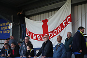 AFC Wimbledon fans hanging a banner during the EFL Sky Bet League 1 match between AFC Wimbledon and Milton Keynes Dons at the Cherry Red Records Stadium, Kingston, England on 22 September 2017. Photo by Matthew Redman.