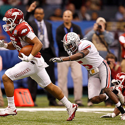 January 4, 2011; New Orleans, LA, USA; Arkansas Razorbacks tight end D.J. Williams (45) runs from Ohio State Buckeyes defensive back Chimdi Chekwa (5) during the first quarter of the 2011 Sugar Bowl at the Louisiana Superdome.  Mandatory Credit: Derick E. Hingle