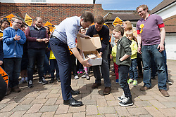 © Licensed to London News Pictures. 04/05/2015. Sutton, UK. Deputy Prime Minister, Nick Clegg with Liberal Democrat candidate for Sutton and Cheam, Paul Burstow present a cake to a young supporter in Sutton. Photo credit : Vickie Flores/LNP