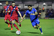 AFC Wimbledon striker Andy Barcham (17) taking on Rochdale midfielder Matthew Lund (8) during the EFL Sky Bet League 1 match between AFC Wimbledon and Rochdale at the Cherry Red Records Stadium, Kingston, England on 28 March 2017. Photo by Matthew Redman.