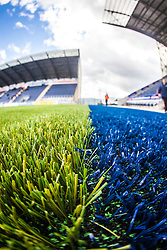An upright image taken with a fish-eye lens showing the new plastic pitch work at The Falkirk Stadium, with the new pitch work for the Scottish Championship game v Morton. The woven GreenFields MX synthetic turf and the surface has been specifically designed for football with 50mm tufts compared with the longer 65mm which has been used for mixed football and rugby uses.  It is fully FFA two star compliant and conforms to rules laid out by the SPL and SFL.<br /> &copy;Michael Schofield.