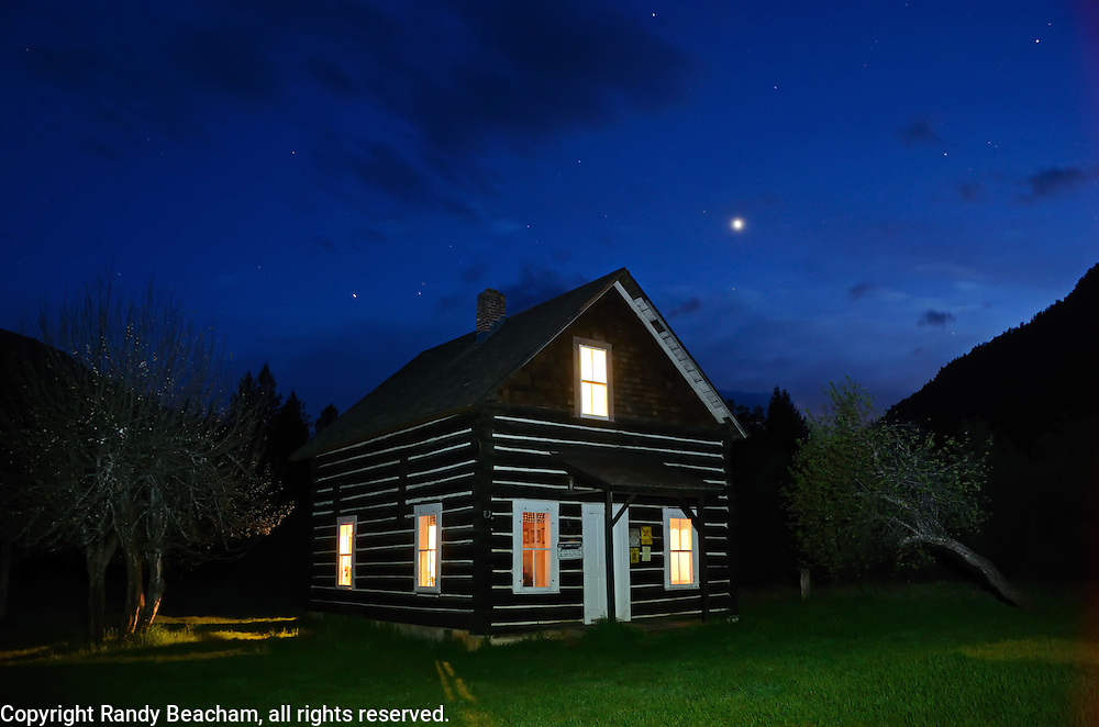 Bull River Guard Station at night, one of the original ranger stations in the Kootenai National Forest now used as a rental cabin. Bull River Valley, northwest Montana.