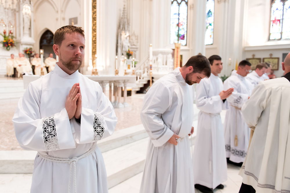 DENVER, CO - MAY 13: Daniel Ciucci prepares to be invested with his stole and chasuble during his ordination to the priesthood at the Cathedral Basilica of the Immaculate Conception on May 13, 2017, in Denver, Colorado. (Photo by Daniel Petty/for Denver Catholic)