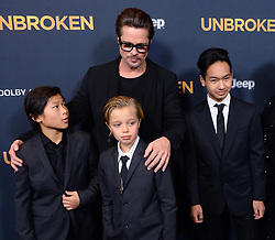 "©2014 NCNA PHOTO 310-828-3445<br /> <br /> Actor Brad Pitt attends the premiere of the biographical motion picture war drama ""Unbroken"" with his children Pax Thien Jolie-Pitt, Shiloh Nouvel Jolie-Pitt,, Maddox Jolie-Pitt (L-R) and his mother Jane Pitt, and father William Pitt at the Dolby Theatre Theatre in the Hollywood section of Los Angeles on December 15, 2014. Storyline: After a near-fatal plane crash in WWII, Olympian Louis Zamperini spends a harrowing 47 days in a raft with two fellow crewmen before he's caught by the Japanese navy and sent to a prisoner-of-war camp.<br /> <br /> NCNA (Mega Agency TagID: MEGAR12975_10.jpg) [Photo via Mega Agency]"