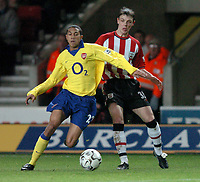 Photo: Richard Lane.<br />Southampton v Arsenal. Barclaycard Premiership.<br />29/12/2003.<br />Gael Clichy breaks away from Chris Baird.