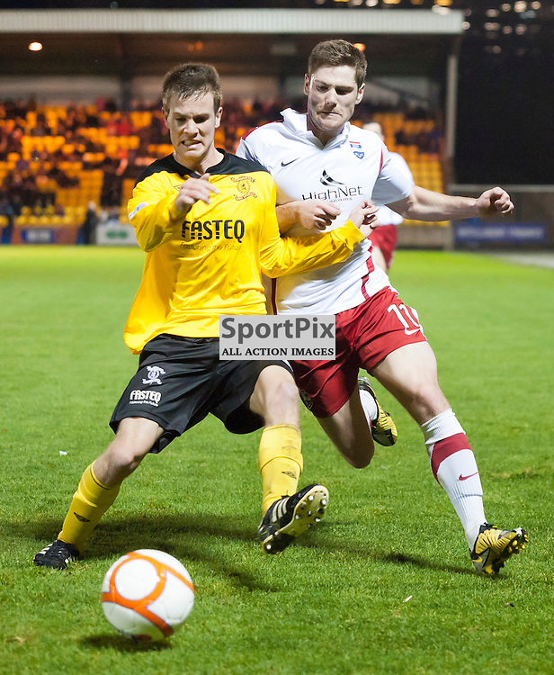 Iain Vigurs out muscles Kyle Jacobs to win the ball and get a cross in for Colin McMenamin to score, Livingston v Ross County SFL Division 1 League Match