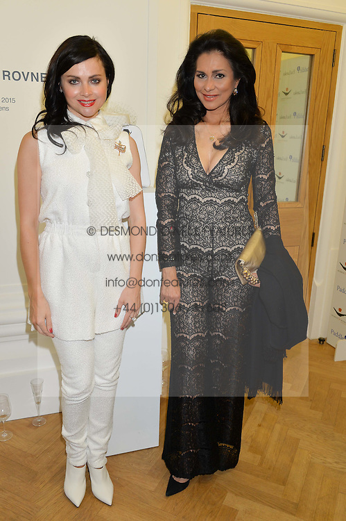 Left to right, EVA LANSKA and LADY FORSYTH at a private view and auction of millinery organised by author, philanthropist and hat collector Eva Lanska in aid of Women for Women International held at Pace, Burlington Gardens, London on 10th June 2015.